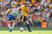 Newport County midfielder Joss Labadie (4) fouls Tranmere Rovers midfielder Oliver Banks (28) during the EFL Sky Bet League 2 Play Off Final match between Newport County and Tranmere Rovers at Wembley Stadium, London, England on 25 May 2019.