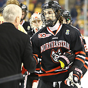 Cody Ferriero #79 of the Northeastern Huskies shakes hands with Head Coach Jerry York of the Boston College Eagles following The Beanpot Championship Game at TD Garden on February 10, 2014 in Boston, Massachusetts. (Photo by Elan Kawesch)