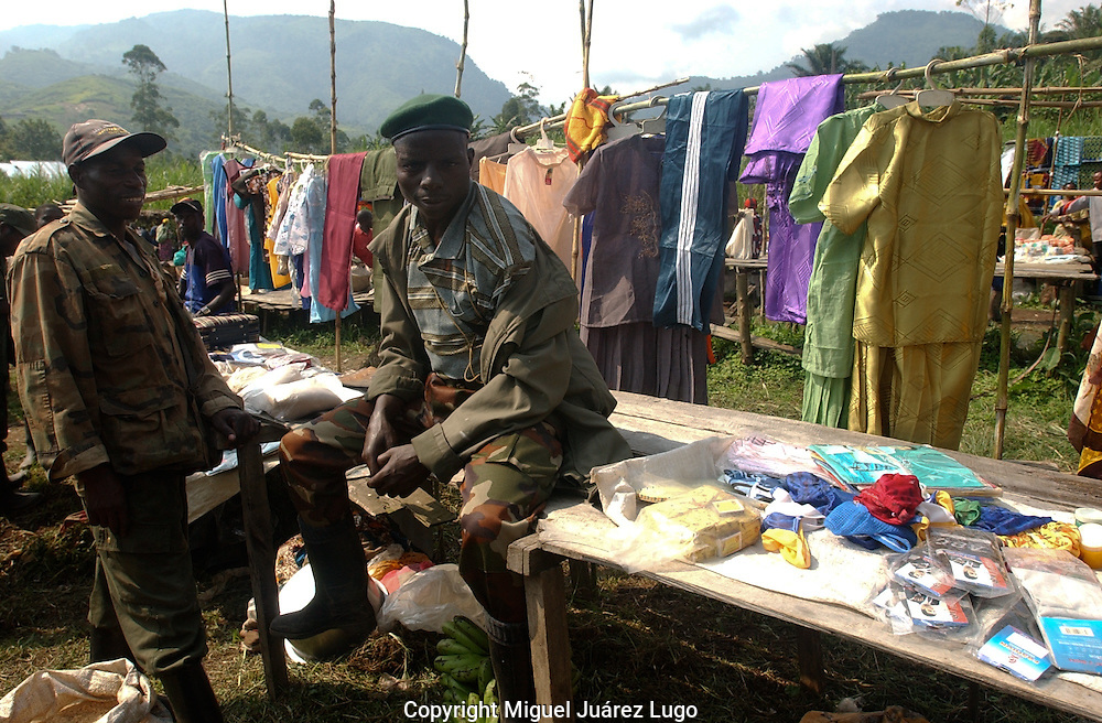 Nyabiondo. D.R.C.   FDLR rebel sodliers offer their goods in the markey of this eastern Congo little town.