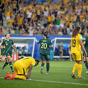GRENOBLE, FRANCE June 18.  Sam Kerr #20 of Australia celebrates her third goal with Hayley Raso #16 of Australia and Chloe Logarzo #6 of Australia as the Australian fans go wild during the Jamaica V Australia, Group C match at the FIFA Women's World Cup at Stade des Alpes on June 18th 2019 in Grenoble, France. (Photo by Tim Clayton/Corbis via Getty Images)
