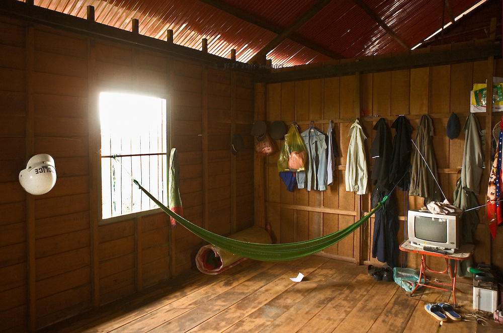 Tonle Sap lake police checkpoint near Chong Kneas includes a room where the policemen rest.  A motorcycle helmet hangs on the wall, together with clean shirts.  A hammock and television set indicate how rest hour time is passed.  The otherwise empty room has a quiet, peaceful atmosphere.