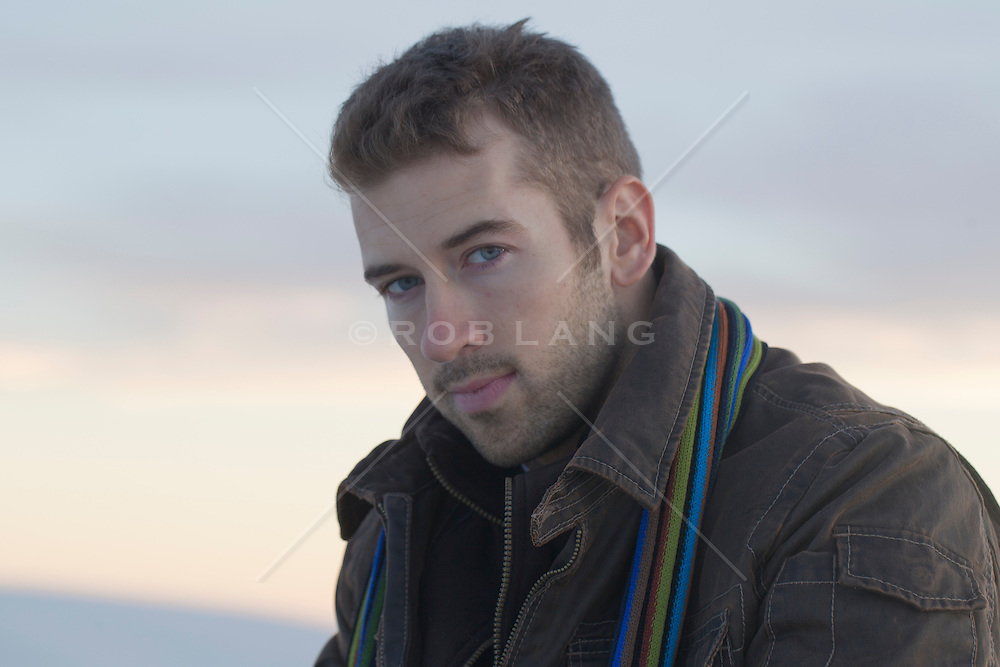 handsome rugged young man outdoors