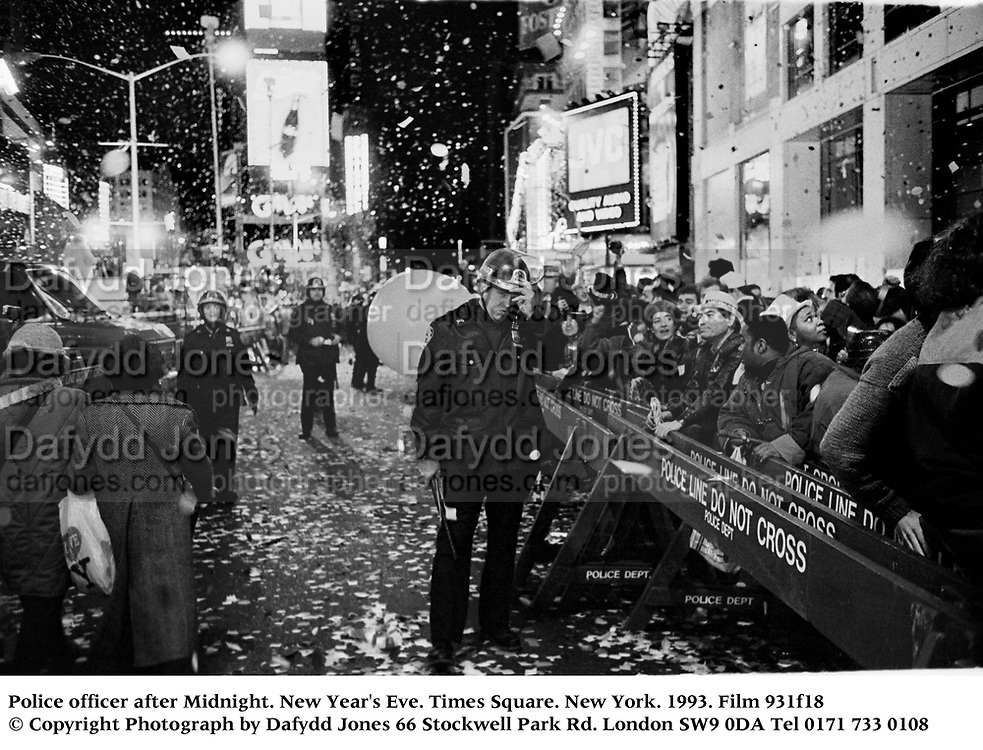 Police officer after Midnight. New Year's Eve. Times Square. New York. 1993. Film 931f18<br />© Copyright Photograph by Dafydd Jones<br />66 Stockwell Park Rd. London SW9 0DA<br />Tel 0171 733 0108