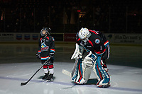 KELOWNA, CANADA - OCTOBER 5: The Save-On Foods player of the game lines up on the blue line with James Porter #1 of the Kelowna Rockets against the Victoria Royals  on October 5, 2018 at Prospera Place in Kelowna, British Columbia, Canada.  (Photo by Marissa Baecker/Shoot the Breeze)  *** Local Caption ***