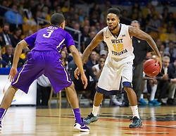 Nov 16, 2015; Charleston, WV, USA; West Virginia Mountaineers guard Tarik Phillip dribbles at the top of the key during the first half against the James Madison Dukes at the Charleston Civic Center. Mandatory Credit: Ben Queen-USA TODAY Sports