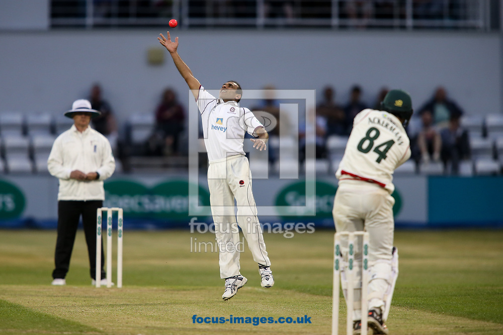 Muhammad Azhar Ullah of Northamptonshire CCC (centre) fields his own bowling during the Specsavers County C'ship Div Two match at the County Ground, Northampton<br /> Picture by Andy Kearns/Focus Images Ltd 0781 864 4264<br /> 26/06/2017