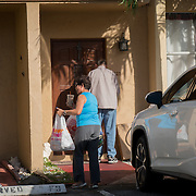 NORTH MIANI, FLORIDA, NOVEMBER 8, 2016<br /> Move On volunteers Francie Peake, interacts with an early voter for Hillary Clinton as she went  knocking on doors of homes of voters in the North Miami area as they canvass for democratic votes.<br /> (Photo by Angel Valentin/Freelance)