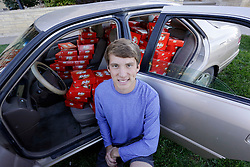 IMAGE DISTRIBUTED FOR THE HERSHEY COMPANY - Hunter Jobbins, freshman at Kansas State University poses with his car filled with nearly 6,500 Kit Kat bars on Thursday, Nov. 3, 2016, in Manhattan, Kansas. Earlier this week, Jobbins had a Kit Kat bar stolen from his unlocked car and a mysterious note was left from the thief. (Colin E. Braley/AP Images for The Hershey Company)