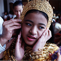 A dancer from the Angkor Dance troupe gets help with her costume before her performance at the Rogers School in Lowell. photo by Tory Germann