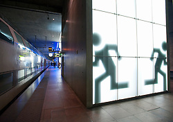 Illuminated signs at emergency exits at Antwerp central railway station in Belgium