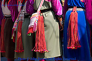Ethnic Lisu women are wearing colorful traditional costumes a ceremony in Pai, Northern Thailand.