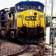 Colorful freight trains ride the rails.
