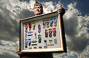 Sgt. Billy Jones outside his home in Langley, OK, with the medals he won during the three wars he fought in - World War II, Korea and Vietnam.