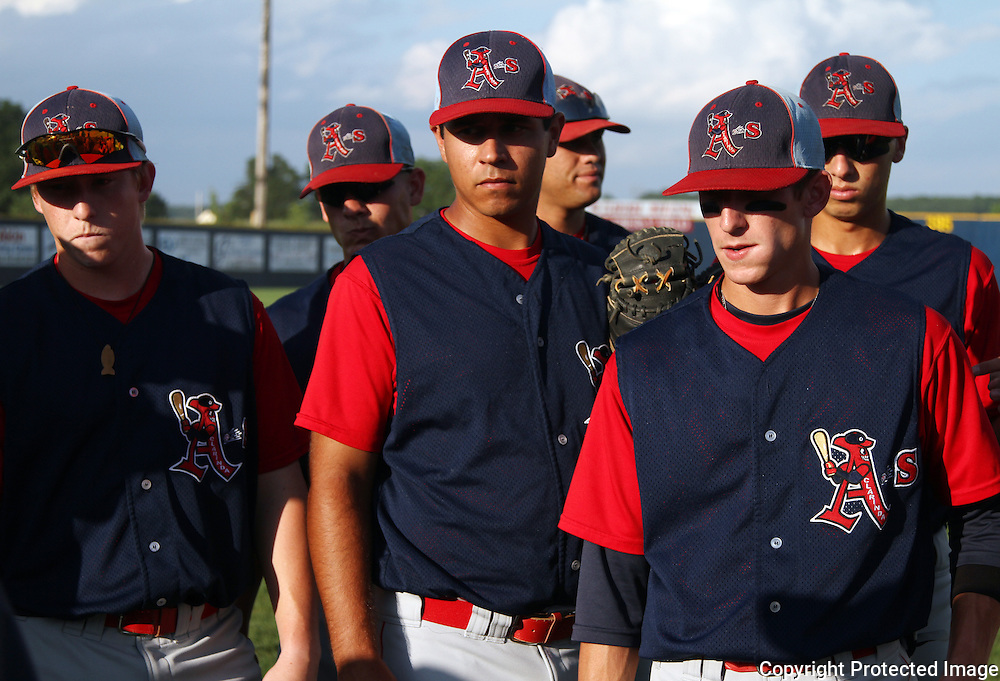 HIDDEN EYES - The bills of their caps cast heavy shadows over the faces of this group of Clarinda A's as they listen during a team meeting.  From left are Danny Casey, Ryan Peterson, Mike Lopez, Stuart Smith, Severino Alvarez and Steven Greenberg.  photo buy David Peterson