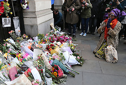 A mourner outside  South Africa House in London, Friday, 6th December 2013, following the death Nelson Mandela, Picture by Stephen Lock / i-Images