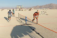 Someone setup a nice little tennis court on the playa. These guys just automatically started being the ball boys. Their technique was inpecable and hilarious. You don't watch Burning Man like a festival with performances on stage, at Burning Man everyone is on the stage and we all built the stage.