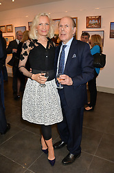 BRYAN LINCOLN and his wife JOLANTA at a private view of work by artist Philip Bouchard at 508 Gallery, 508 King's Road, London on 3rd April 2014.