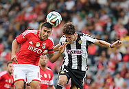 Portugal, FUNCHAL :Benfica's Argentine midfielder Salvio   vies with Nacional´s Portuguese forward Mario Rondon during the Portuguese league football match CD Nacional vs Benfica at the Madeira stadium in Funchal on November 09, 2014.  AFP PHOTO / GREGORIO CUNHA