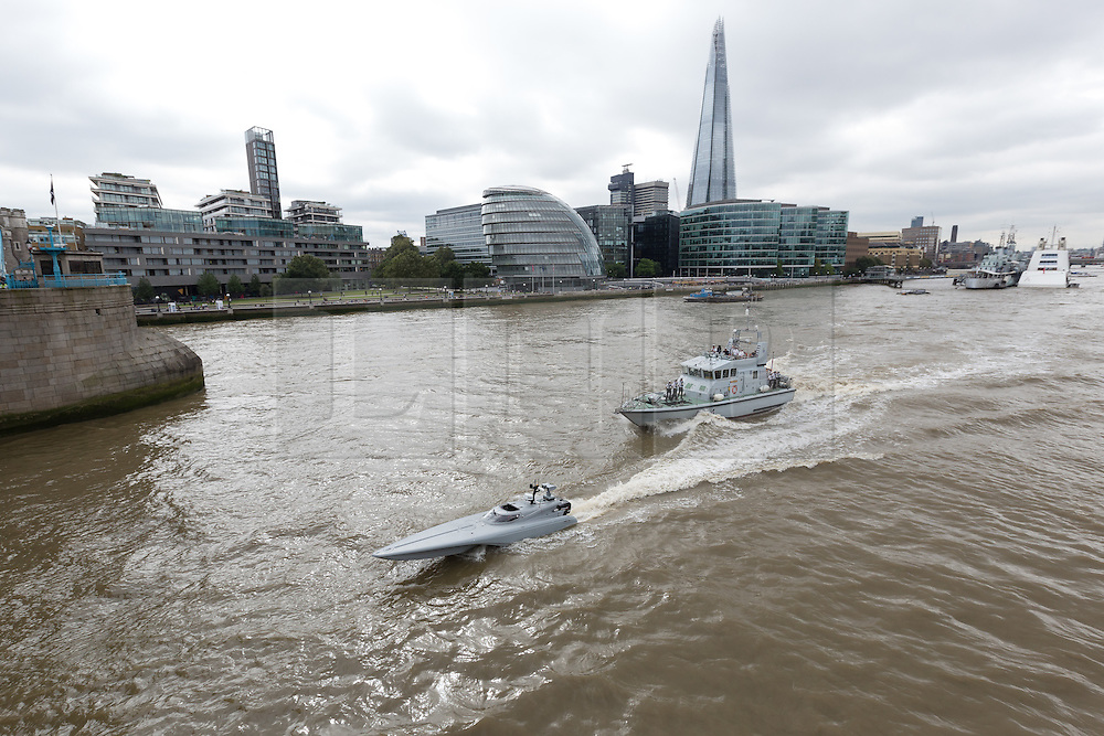 © Licensed to London News Pictures. 05/09/2016. LONDON, UK.  Bladerunner passing the London Shard with HMS Anchor on the River Thames. The Royal Navy test out Bladerunner, their new prototype high speed drone speedboat on the River Thames in London this afternoon ahead of a major exercise. It is part of the Royal Navy's Unmanned Arrior program, which seeks to find an edge in the field of naval combat.  Photo credit: Vickie Flores/LNP