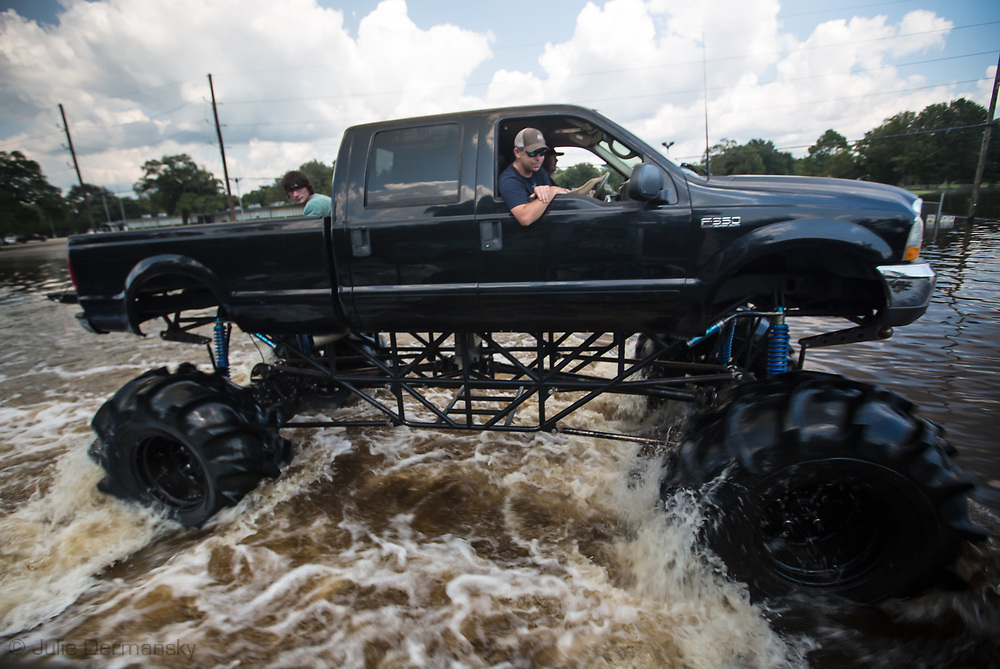 Sept 1, 2017  volenteers on rescue mission in a Monster Truck in Vidor, Texas. Though  Hurricane Harvey, was downgraded to a tropical storm when it flooded Vidor, Texas and the sourounding area, the area was badly flooded.