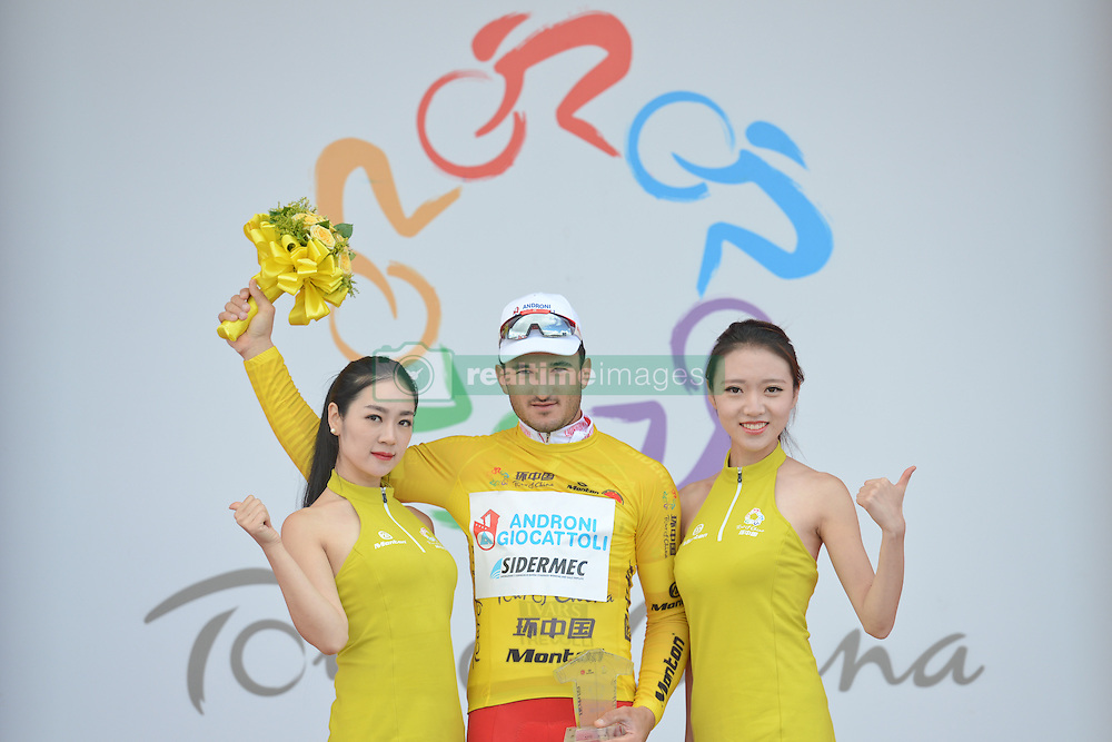 September 10, 2016 - Fengning, China - Italian Marco Benfatto from Androni-Giocattoli Team with a Yellow Leader Jersey, after he wins the second stage, 157.8 km Weichang-Fengning, of the 2016 Tour of China 1...The second stage of the Tour of China starts in Yudaokou, in Weichang county, located at the far northeastern Hebei province. The area has been historically home to Manchu soldiers. ..The stage finishes in Fengning county, in front of Great Khan palace on north grassland of the country...On Saturday, 10 September 2016, in Fengning, China. (Credit Image: © Artur Widak/NurPhoto via ZUMA Press)