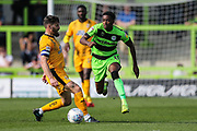 Forest Green Rovers Reece Brown(10) skips past Cambridge United's Gary Deegan(6) during the EFL Sky Bet League 2 match between Forest Green Rovers and Cambridge United at the New Lawn, Forest Green, United Kingdom on 22 April 2019.