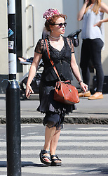 Actress Helena Bonham Carter wearing flowers in her hair, pearl necklace, black lace dress and sandals out and about in north London, UK. 09/07/2015<br />
