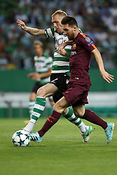 September 27, 2017 - Lisbon, Portugal - Barcelona's Argentine forward Lionel Messi (R ) vies with Sporting's defender Jeremy Mathieu from France during the UEFA Champions League football match Sporting vs Barcelona at the Alvalade stadium in Lisbon, Portugal on September 27, 2017. Photo: Pedro Fiuza  (Credit Image: © Pedro Fiuza/NurPhoto via ZUMA Press)