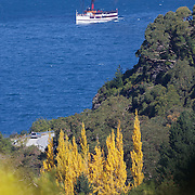The TSS Earnslaw,  a 1912 Edwardian vintage twin screw steamer on the waters of Lake Wakatipu in, Queenstown, New Zealand. .It is one of the oldest tourist attractions in Central Otago, and the only remaining passenger-carrying coal-fired steamship in the southern hemisphere..The TSS Earnslaw heads along Lake Wakatipu from Queenstown  daily, running tourist trips to Walter Peak Station passing magnificent  peaks and contrasting shoreline foliage along the lakeside. Queenstown, New Zealand. 10th April 2011. Photo Tim Clayton