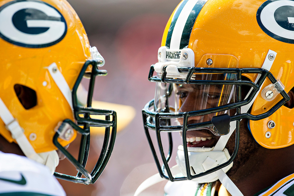 CHICAGO, IL - SEPTEMBER 13:  Two players of the Green Bay Packers on the sidelines before a game against the Chicago Bears at Soldier Field on September 13, 2015 in Chicago, Illinois.  The Packers defeated the Bears 31-23.  (Photo by Wesley Hitt/Getty Images) *** Local Caption ***
