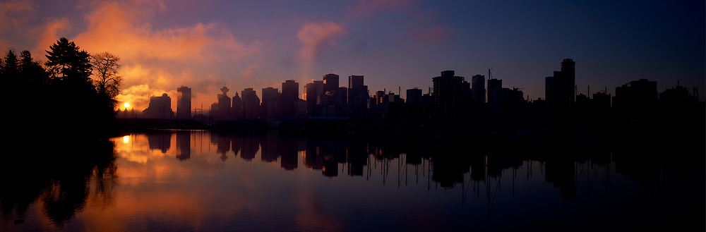 Skyline and Stanley Park in fog at sunrise