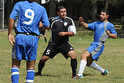 Ivan Rodriguez (#5) of Deportivo Colomex defends his goal against Team Shlama F.C. during National Soccer League play in Skokie, Il.
