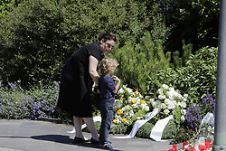 June 19, 2017 - Oggersheim, Rhineland-Palatinate, Germany - A mother and her child look at the flowers, candles and messages laid down outside the former residence of Helmut Kohl. Long term political companion Theo Waigel, who served as German Minister of Finance under Helmut Kohl, came to pay his respects to his widow 3 days after the death of the former German Chancellor in his home in Oggersheim. (Credit Image: © Michael Debets/Pacific Press via ZUMA Wire)