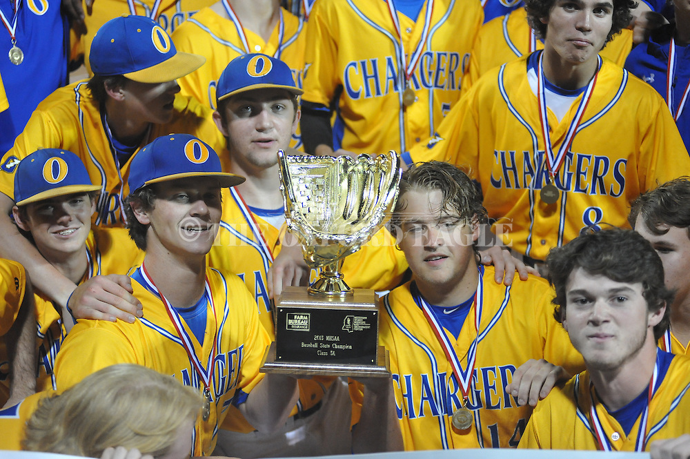 Oxford High's Jason Barber (7) and Jack McClure (14) hold the championship trophy vs. George County in the MHSAA Class 5A state championship at Trustmark Park in Pearl, Miss. on Thursday, May 21, 2015. Oxford won 9-0 to win its second state title in baseball and its first since 2005.