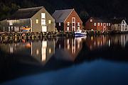 Nightshot of boathouses in Fosnavåg harbour, Norway | Nattbilde av nausta i fosnavåg havn, Norge.
