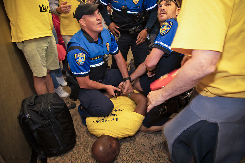 Pastor Gregory Manning, with Justice and Beyond, a New Orleans based civil rights advocacy group, pinned to the ground while being handcuffed by police in the <br /> hallway outside of LABI's office in downtown Baton Rouge, Louisiana, on October 30.