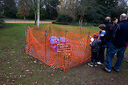 Londoners view stolen Barbara Hepworth sculpture Two Forms (1969) stolen from Dulwich Park where it was installed for 40 years. ..Dame Barbara Hepworth DBE (10 January 1903 – 20 May 1975) was an English sculptor. Her work exemplifies Modernism, and with such contemporaries as Ivon Hitchens, Henry Moore, Ben Nicholson, Naum Gabo she helped to develop modern art (sculpture in particular) in Britain.