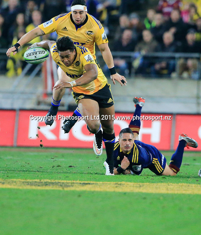 Hurricanes Julian Savea steps though a tackle. Super Rugby Final, Hurricanes v Highlanders. Westpac Stadium, Wellington, New Zealand. 4 July 2015. Copyright Photo: John Cowpland / www.photosport.nz