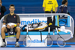 © Licensed to London News Pictures. 27/01/2013. Melbourne Park, Australia. Novak Djokovic resting during the Mens Final between Novak Djokovic and Andy Murray of the Australian Open. Photo credit : Asanka Brendon Ratnayake/LNP