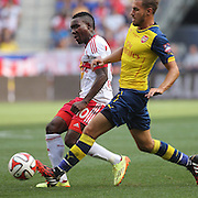 Lloyd Sam, (left), New York Red Bulls, challenged by Aaron Ramsey, Arsenal, during the New York Red Bulls Vs Arsenal FC,  friendly football match for the New York Cup at Red Bull Arena, Harrison, New Jersey. USA. 26h July 2014. Photo Tim Clayton