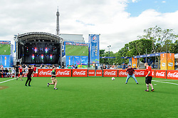 Fans from Wales and England play football beneath the Eiffel Tower in Paris, ahead of their countries meeting in Group B on Thursday. Images from the UEFA EURO 2016, 14 June 2016 in Fan Zone. (c) Paul Roberts | Edinburgh Elite media. All Rights Reserved