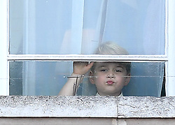 Prince George picks his nose as he and Princess Charlotte watch Trooping the Colour at Buckingham Palace, London, UK, on the 17th June 2017. 17 Jun 2017 Pictured: Prince George. Photo credit: James Whatling / MEGA TheMegaAgency.com +1 888 505 6342