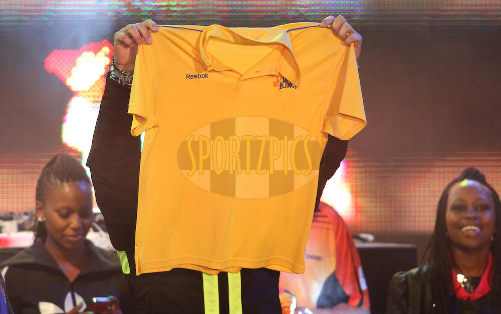 Chennai Super Kings Ambassador Sasha Martinengo holds up a Chennai Super Kings shirt during the Karbonn Smart CLT20 South Africa Opening Celebration held at Melrose Arch in Johannesburg, South Africa on the 12th October 2012..Photo by Shaun Roy/SPORTZPICS/CLT20