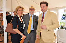 Left to right, VISCOUNT & VISCOUNTESS COWDRAY and JO THORNTON MD Veuve Clicquot UK at the 2012 Veuve Clicquot Gold Cup Final at Cowdray Park, Midhurst, West Sussex on 15th July 2012.