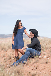 girl admiring a rugged cowboy outdoors