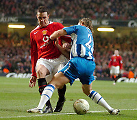 Photo: Ed Godden.<br />Manchester United v Wigan Athletic. The Carling Cup Final. 26/02/2006. John O'Shea (L) and Reto Ziegler of Wigan, clash in the Man Utd area.