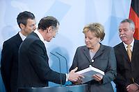 12 NOV 2008, BERLIN/GERMANY:<br /> Prof. Dr. Bert Ruerup, Wirtschaftswissenschaftler TU Darmstadt, und Angela Merkel (R), CDU, Bundeskanzlerin, waehrend der Uebergabe des Jahresgutachtens 2008/2009 des Sachverstaendigenrates zur Begutachtung des gesamtwirtschaftlichen Entwicklung an die Bundeskanzlerin, Bundeskanzleramt<br /> IMAGE: 20081112-02-022<br /> KEYWORDS: Bert Rürup, Wirtschaftsweise, Sachverständigenrat