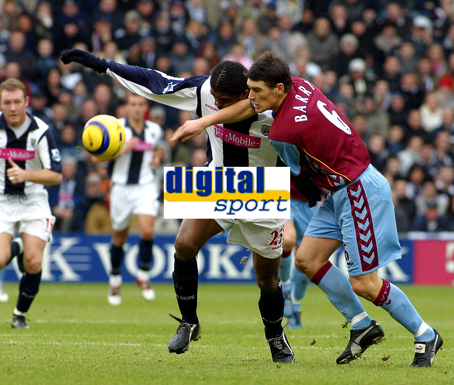 Photo: Dave Linney.<br />West Bromwich Albion v Aston Villa. The Barclays Premiership. 02/01/2006.West Brom's Kanu(L) in a battle with  Gareth Barry.