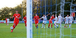 BANGOR, WALES - Monday, October 15, 2018: Wales' Brennan Johnson scores the first goal from the penalty spot during the UEFA Under-19 International Friendly match between Wales and Poland at the VSM Bangor Stadium. (Pic by Paul Greenwood/Propaganda)