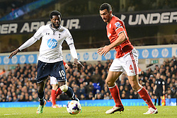 Tottenham's Emmanuel Adebayor and Cardiff's Steven Caulker  - Photo mandatory by-line: Mitchell Gunn/JMP - Tel: Mobile: 07966 386802 02/03/2014 - SPORT - FOOTBALL - White Hart Lane - London - Tottenham Hotspur v Cardiff City - Premier League